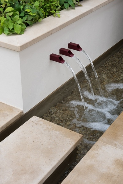 Water shoots in a low wall with raised bed behind