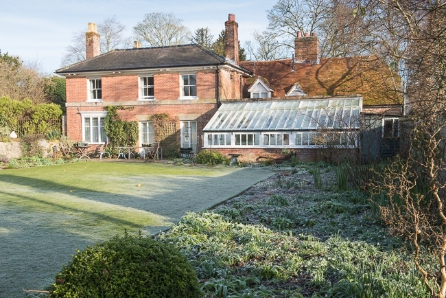 House, conservatory, lawn and herbaceous borders