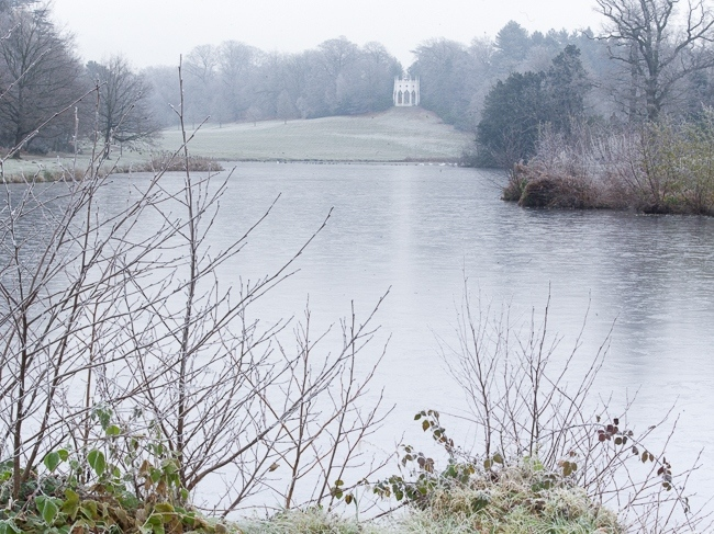 Painshill Park landscape garden overlooking the frozen lake with the Gothic Temple in the background